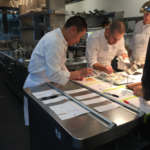chef lee and chef de cuisine at the pass